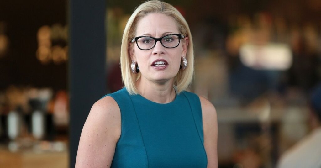 U.S. Congresswoman Kyrsten Sinema speaking with supporters at a neighborhood canvas hosted by the Arizona Education Association at Provision Coffee Arcadia in Phoenix, Arizona.